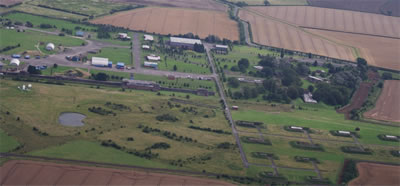 Aerial view of the former RAF Faldingworth showing some of the fissile material storage buildings to the lower right.