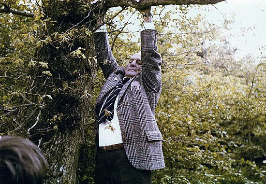Don hanging from the very same tree in 1977, that he landed in back in April 1944